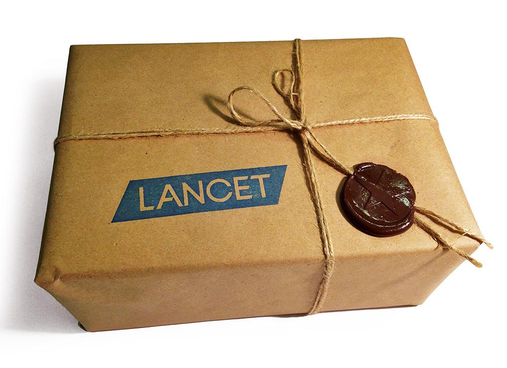 Подарочная коробка с логотипом Lancet и сургучом