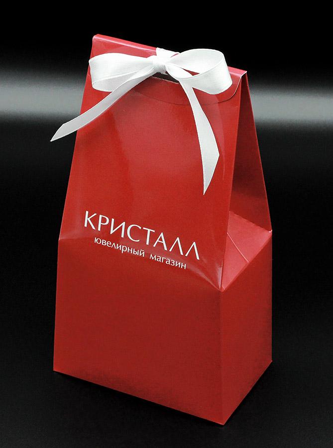 Конфеты в коробке-мешочке с символикой магазина Кристалл