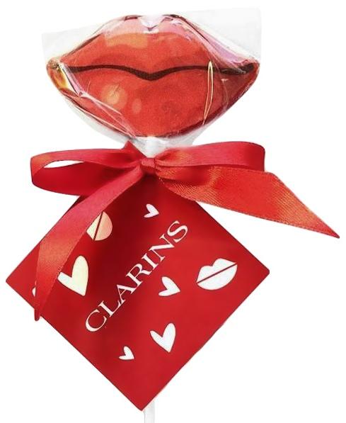 Леденцы-губки с ленточкой и логотипом Clarins на бирке